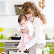 mother and her little daughter using tablet pc