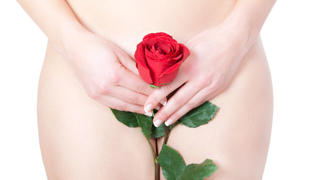 Beautiful blond nude woman with rose