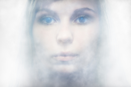 Picture a beautiful angelic woman in the fog