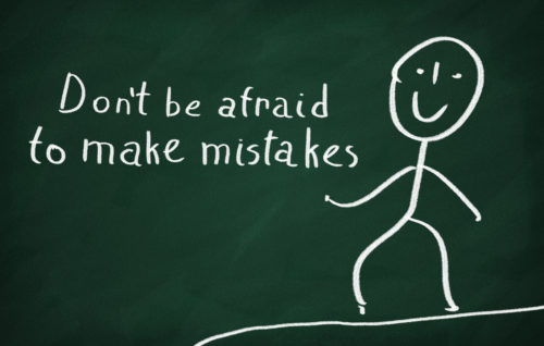 On the blackboard draw character and write Don't be afraid to make mistakes